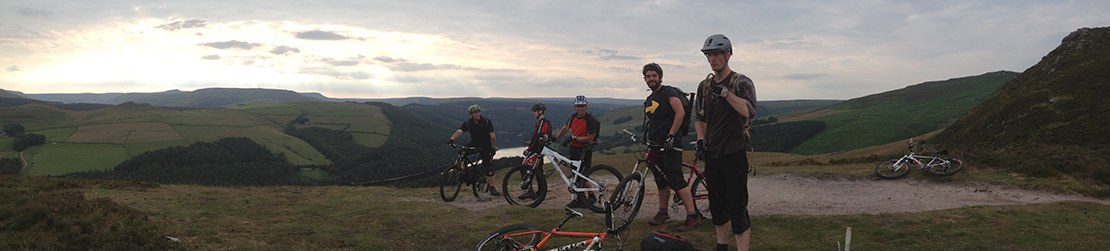 Mountain bikers overlooking a reservoir